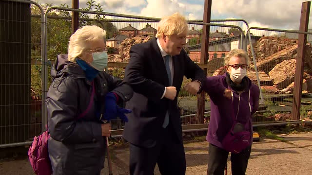 boris johnson pm, elbow bumps elderly women in stourbridge, as he campaigns for the conservative party in the local elections - conservative party uk stock videos & royalty-free footage
