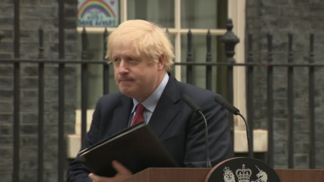 boris johnson pm finishes his return to office speech after recovering from coronavirus and walks back into number 10 downing street, rainbow... - boris johnson stock videos & royalty-free footage