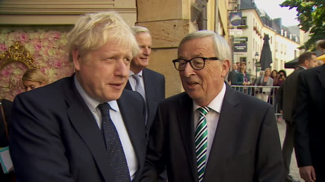 boris johnson pm greets jean claude junker and michel barnier outside luxembourg restaurant and says about a brexit deal we are cautious - discussion stock videos & royalty-free footage
