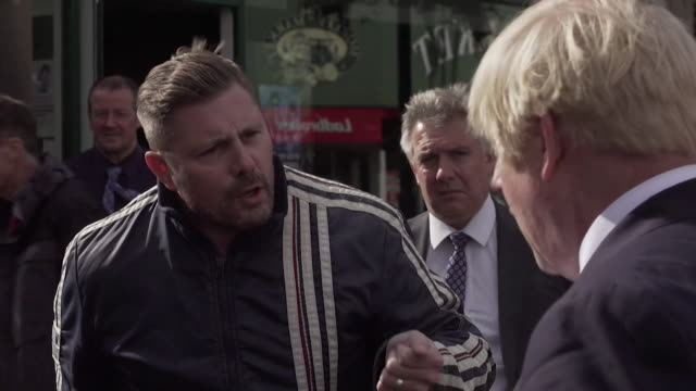 "boris johnson pm heckled during walkabout in morley, gentleman says about a brexit deal ""you're playing games, the whole country knows this"" - anger stock videos & royalty-free footage"
