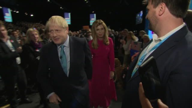 boris johnson pm leaves conservative party conference after speech with girlfriend carrie symonds - boris johnson stock videos & royalty-free footage