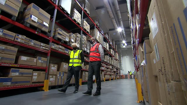 "boris johnson pm, looking around warehouse at oxford biomedica, one of the companies responsible for manufacturing the oxford astrazeneca covid-19... - ""bbc news"" stock videos & royalty-free footage"