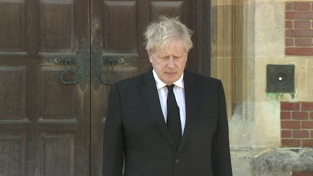 """boris johnson pm observes a minute's silence outside chequers in buckinghamshire, to pay tribute to prince philip on the day of his funeral - """"bbc news"""" stock-videos und b-roll-filmmaterial"""
