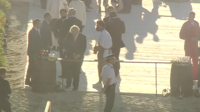 boris johnson pm on carbis bay beach having a drink with french president emmanuel macron, at g7 summit beach bbq - husband stock videos & royalty-free footage