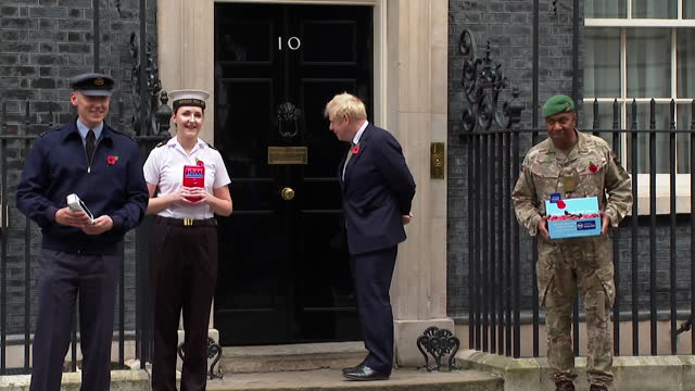 boris johnson pm photocall outside 10 downing stree with poppy fundraisers for the royal british legion for remembrance day - military stock videos & royalty-free footage