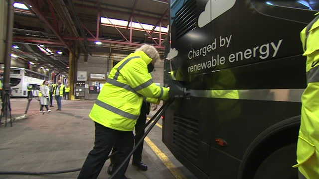 boris johnson pm, plugging charger into electric bus at bus depot in coventry - electrical equipment stock videos & royalty-free footage