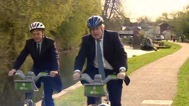 boris johnson pm, riding bike in stourbridge, as he campaigns for the conservative party in the local elections - conservative party uk stock videos & royalty-free footage