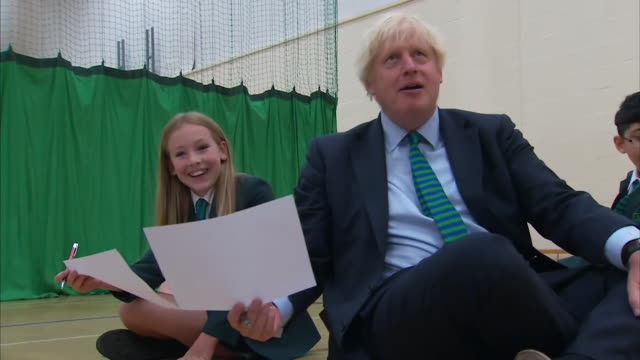 boris johnson pm, sat on floor drawing picture of house, during visit to school in leicester - humour stock videos & royalty-free footage