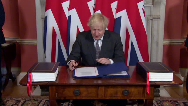 boris johnson pm, signing the brexit eu trade deal, in 10 downing street - writing stock videos & royalty-free footage