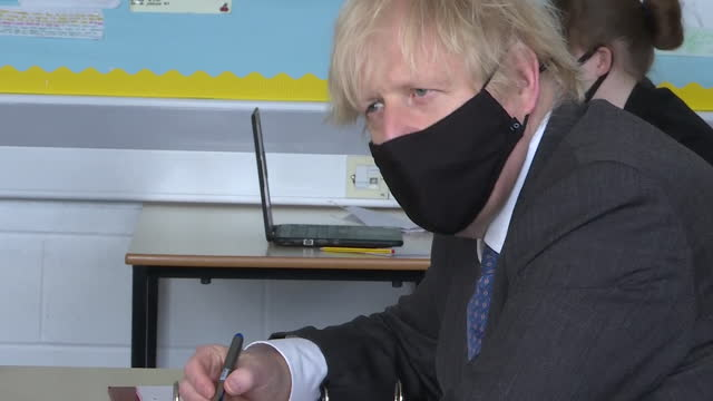 boris johnson pm taking part in online classroom lesson in secondary school, during coronavirus lockdown - part of stock videos & royalty-free footage