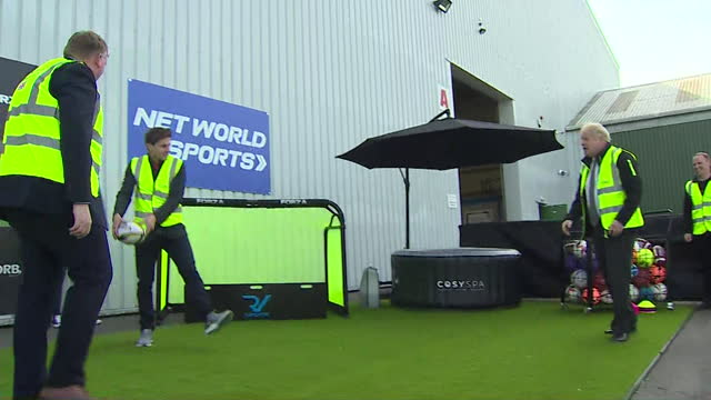 boris johnson pm throws rugby ball at sports supplies warehouse in wrexham - throwing stock videos & royalty-free footage