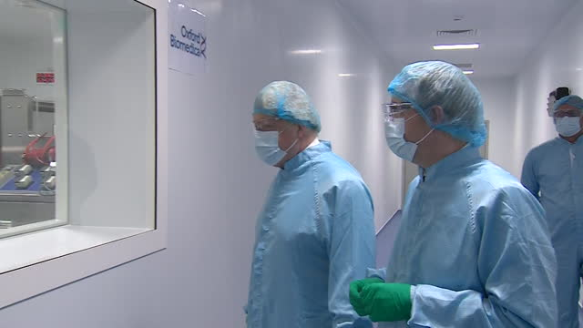 "boris johnson pm, visiting oxford biomedica, one of the companies manufacturing the oxford astrazeneca covid-19 vaccine - ""bbc news"" stock videos & royalty-free footage"