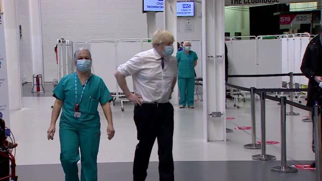boris johnson pm visits covid-19 vaccination centre at ashton gate stadium in bristol - politics and government stock videos & royalty-free footage