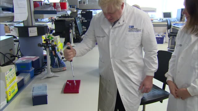 boris johnson pm visits hospital laboratory in cambridge on conservative campaign trail - laboratory coat stock videos & royalty-free footage