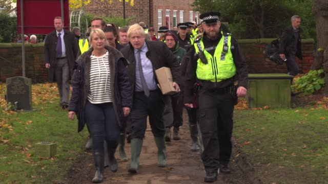 boris johnson pm visits relief centre of the flooded village of fishlake with local resident pam webb, doncaster - civilian stock videos & royalty-free footage