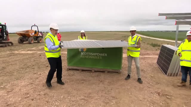 boris johnson pm, visits scottish power renewable project in cornwall, visit to carland cross windfarm and helps lift solar panel into place - working stock videos & royalty-free footage
