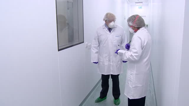 boris johnson pm, visits valneva, a covid-19 vaccine manufacturing site in livingston, scotland - making stock videos & royalty-free footage