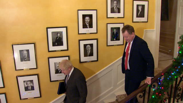 boris johnson pm, walking down stairs in 10 downing street after signing the brexit trade deal with the eu - staircase stock videos & royalty-free footage