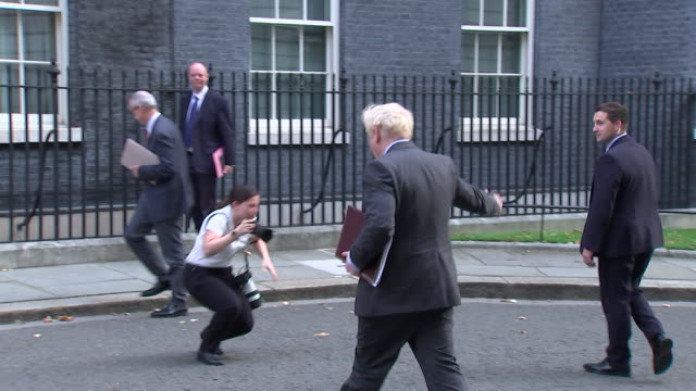 """boris johnson pm walking into 10 downing street the day after announcing tougher restrictions to help combat the coronavirus - """"bbc news"""" stock videos & royalty-free footage"""