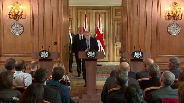 boris johnson pm walks into press conference to outline the government's detailed plan for coronavirus - planning stock videos & royalty-free footage