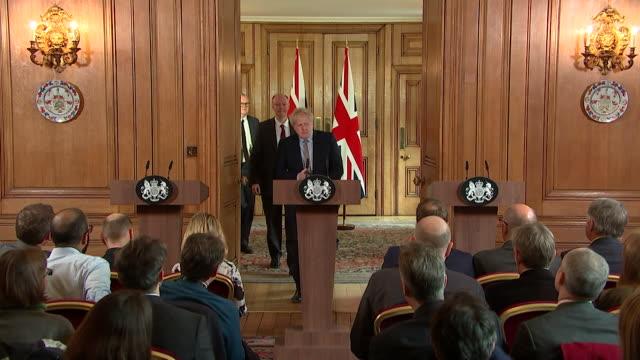 boris johnson pm walks into press conference to outline the government's detailed plan for coronavirus - boris johnson stock videos & royalty-free footage
