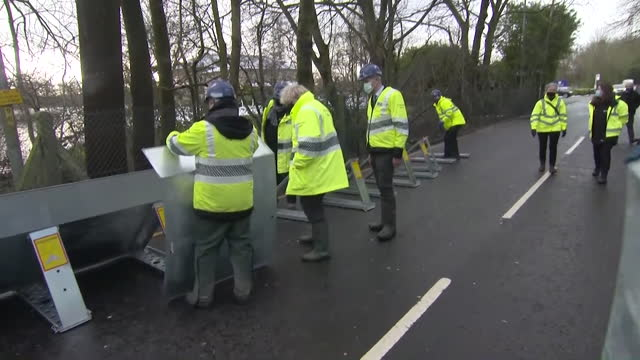 boris johnson pm, watching flood defences be installed in didsbury after storm christoph caused widespread flooding in north england - extreme weather stock videos & royalty-free footage
