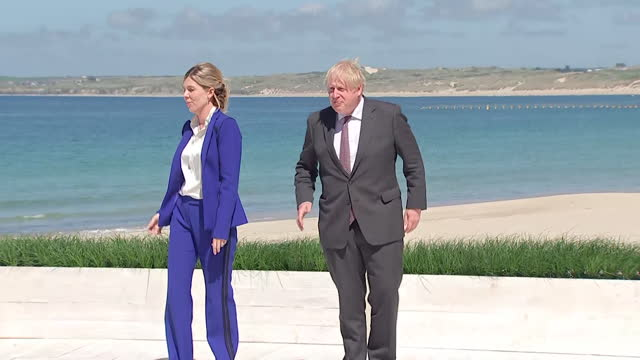 boris johnson pm with wife carrie, on beach at carbis bay, cornwall, waiting for photocalls with extended members of the g7 family - wife stock videos & royalty-free footage