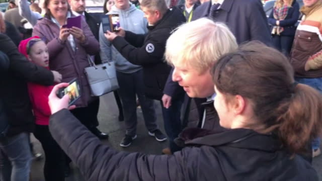boris johnson posing for selfies with supporters on the general election campaign trail - photography themes stock videos & royalty-free footage