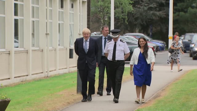 boris johnson prime minister and home secretary priti patel walkabout with police and meeting supporters in birmingham - priti patel stock-videos und b-roll-filmmaterial