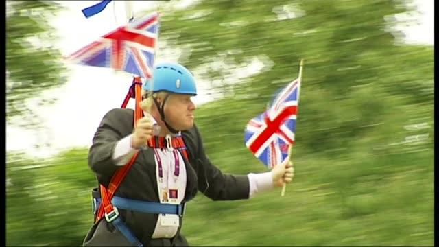 boris johnson profile r01081209 / london victoria park ext boris johnson stuck on zip wire as waving union jack flags boris johnson speaking as stuck... - boris johnson stock-videos und b-roll-filmmaterial