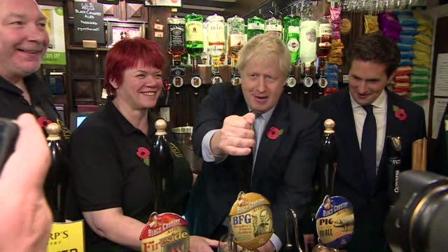 boris johnson pulls pint of beer in wolverhampton pub whilst on the general election campaign trail - conservative party uk stock videos & royalty-free footage