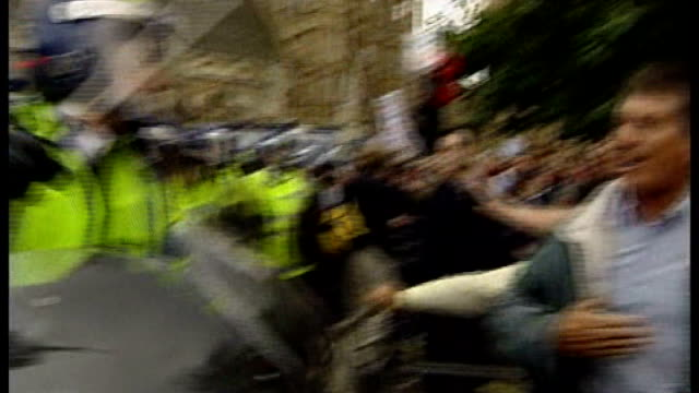 boris johnson questioned over plans to use water cannon on streets of london t15090414 / tx day riot police officers using batons to beat back... - water cannon stock videos and b-roll footage