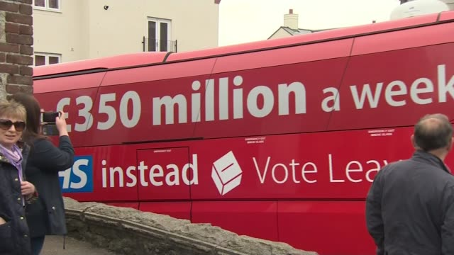 boris johnson rebuked for raising issue of nhs funding lib / 1152016 cornwall st austell ext 'vote leave' campaign battle bus with pledge to spend... - st austell stock videos & royalty-free footage