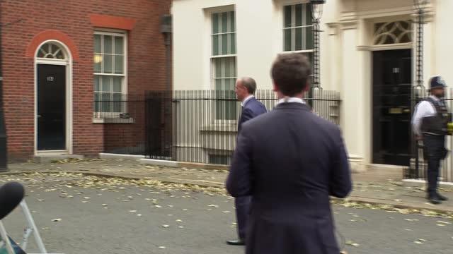 boris johnson reshuffles cabinet; england: london: westminster: downing street: ext door of no 10 downing street door opens dominic raab mp walks... - politics stock videos & royalty-free footage