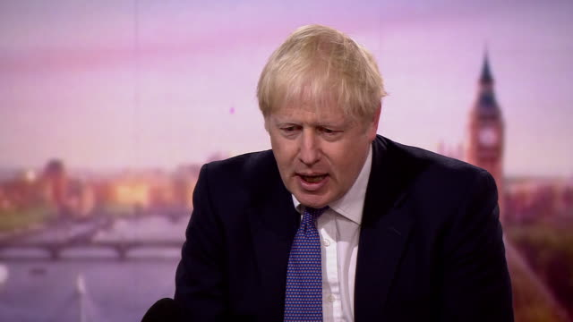 """boris johnson saying by spring 2021 """"we will be in a different world"""" in regards to the coronavirus crisis - leadership stock videos & royalty-free footage"""