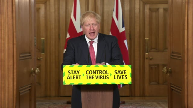 boris johnson saying employers should consult closely with their employees and only ask them to return to their place of work if it is safe - white collar worker stock videos & royalty-free footage