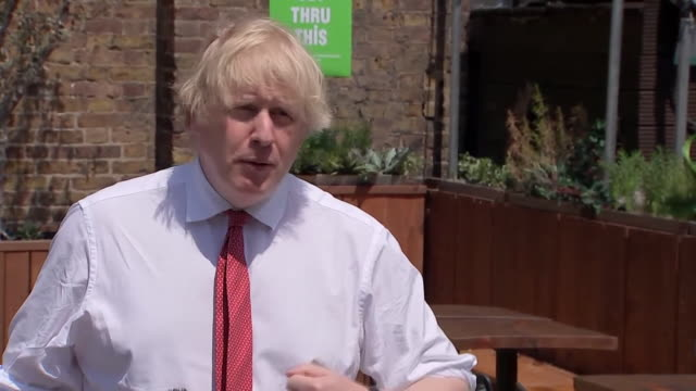 """boris johnson saying people need to understand that people cannot take too many liberties with the coronavirus guidance after huge crowds descended... - """"bbc news"""" stock videos & royalty-free footage"""