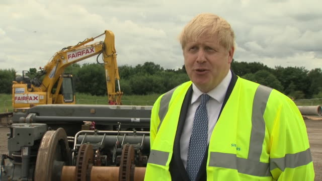 boris johnson saying the government is investing in infrastructure and training to help people get through the coronavirus crisis - construction site stock videos & royalty-free footage