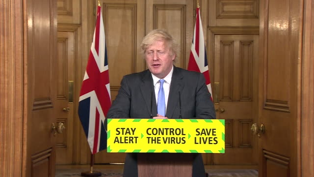"""boris johnson saying the government takes responsibility for deciding to reduce social distancing measures from 2 metres to 1 metre - """"bbc news"""" stock videos & royalty-free footage"""