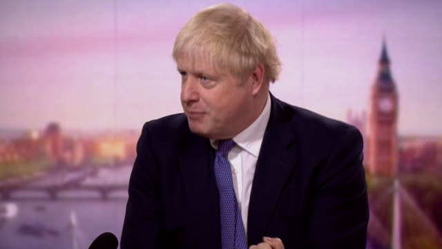 boris johnson saying the government will accelerate progress once coronavirus is under control - investment stock videos & royalty-free footage
