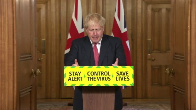 """boris johnson saying the government will give employers """"more discretion"""" to decide how their staff can work safely as coronavirus restrictions are... - teleworking stock videos & royalty-free footage"""