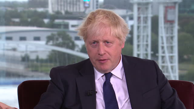 """boris johnson saying the government would rather """"help people into better paid jobs than raise taxes to subsidise low pay"""" - party social event stock videos & royalty-free footage"""