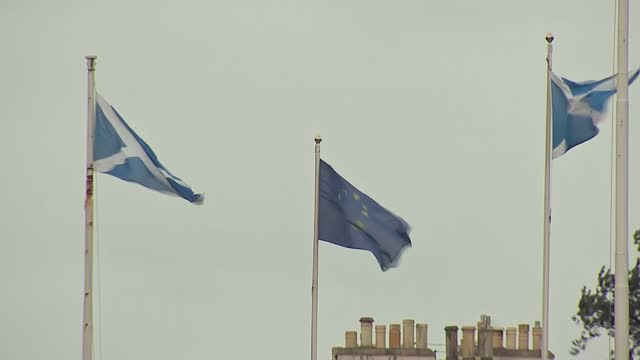 boris johnson sparks row after calling scottish devolution a 'disaster'; scotland: edinburgh: ext wide shot of edinburgh castle walls high angle shot... - flag stock videos & royalty-free footage