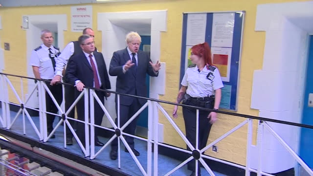 boris johnson speaking to a prison guard on a visit to hm prison leeds - prison guard stock videos & royalty-free footage