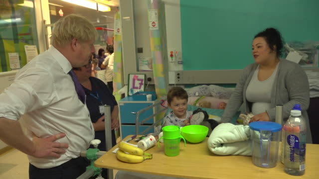 boris johnson speaking to a young patient's mother on a visit to a hospital - parent stock videos & royalty-free footage