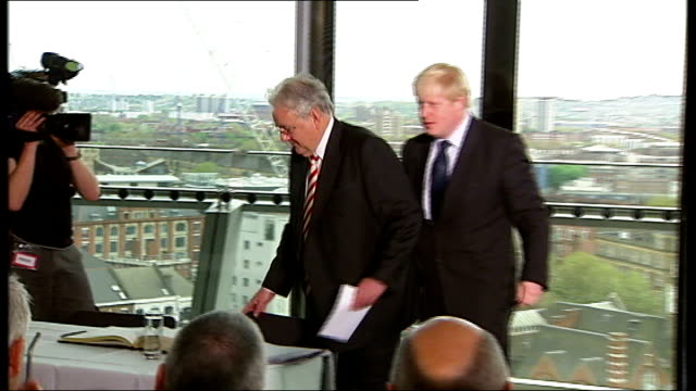 boris johnson sworn in as new london mayor; johnson drinking glass of water as mayer introduces him sot johnson rising then sitting down again as... - mayor stock videos & royalty-free footage