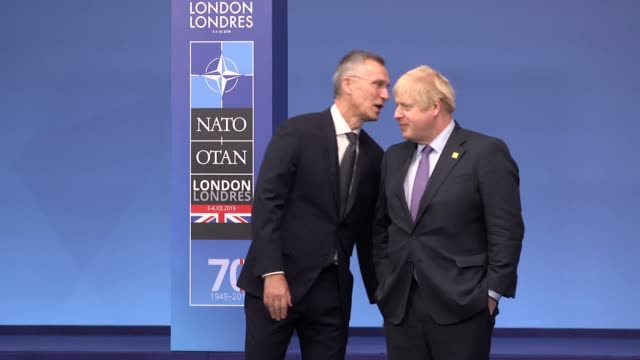 boris johnson takes pictures with world leaders at the nato summit in watford united kingdom introduced are us president donald trump canadian prime... - chancellor of germany stock videos & royalty-free footage
