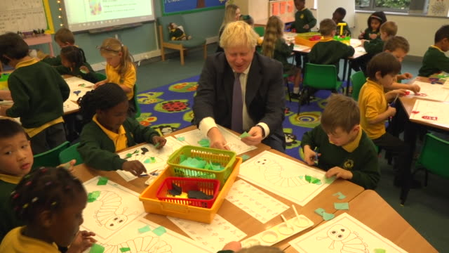 boris johnson taking part in lessons on a visit to a primary school - shears stock videos & royalty-free footage