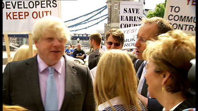 boris johnson to take part in ridelondonsurrey 100 cycle challenge photocall / interview group of protesters delivering petition against knocking... - earls court stock videos & royalty-free footage