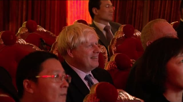 boris johnson trade visit **music heard sot** 'the beatles' tribute act performing / brogue shoes / men dressed as irish guards / johnson sitting in... - tribute event stock videos & royalty-free footage